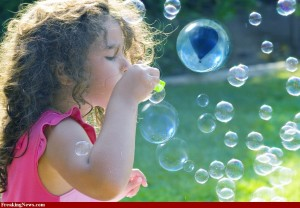 blowing soap bubble