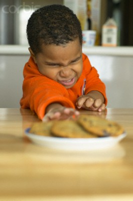 Little Boy Reaching out to Cookies