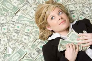 woman-lies on a bed of-money2